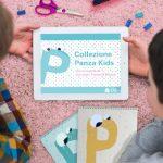 Bambini davanti al tablet per i laboratori digitali Collezione Panza Kids